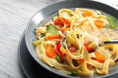 Chicken noodle soup in bowl
