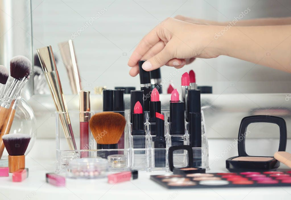 artist with cosmetics at beauty salon