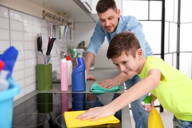 Dad and son doing cleaning