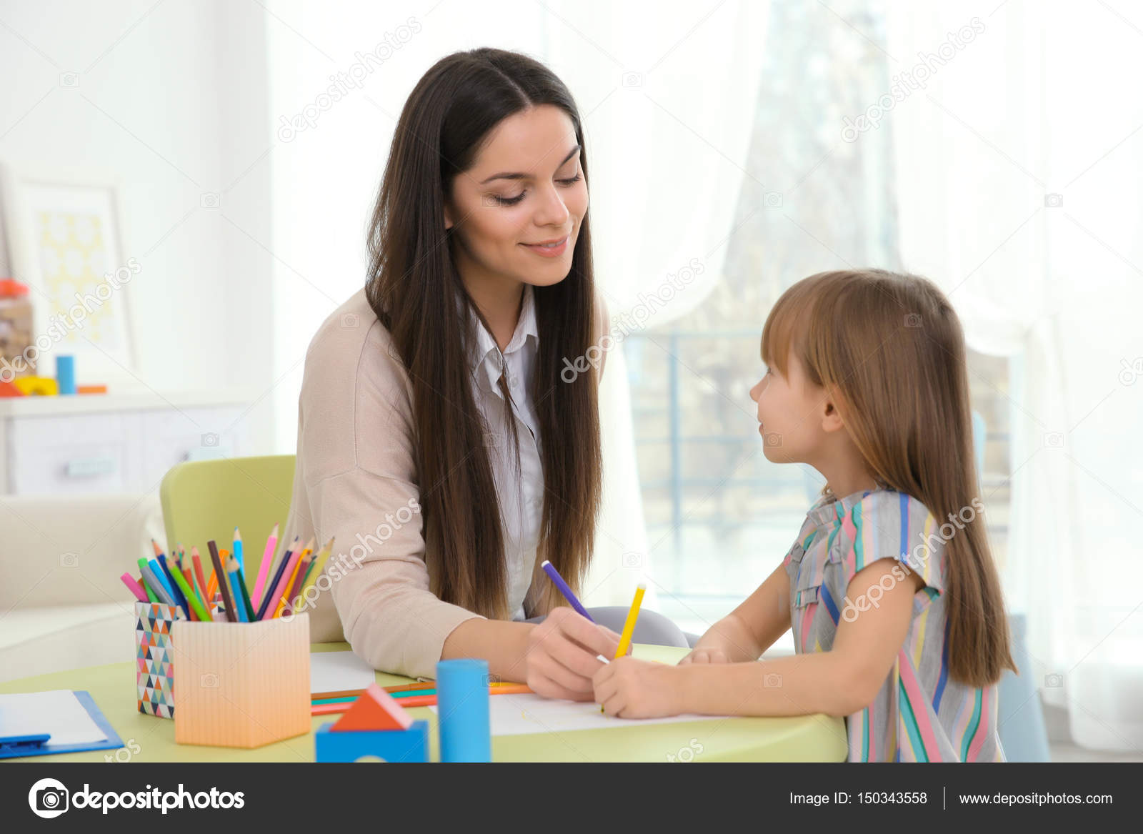 Young child psychologist working with little girl — Stock Photo ...