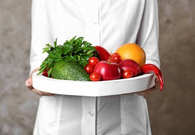 Doctor holding board with healthy food