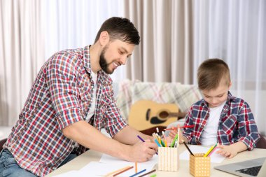 Father and son drawing pictures