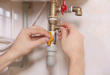 Plumber working with plumbing fittings