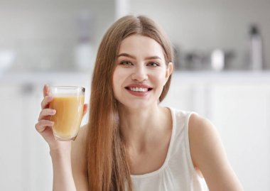 Young woman tasting juice