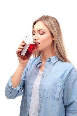 Beautiful woman drinking fresh