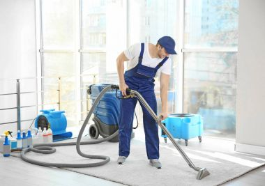 Dry cleaners employee removing dirt
