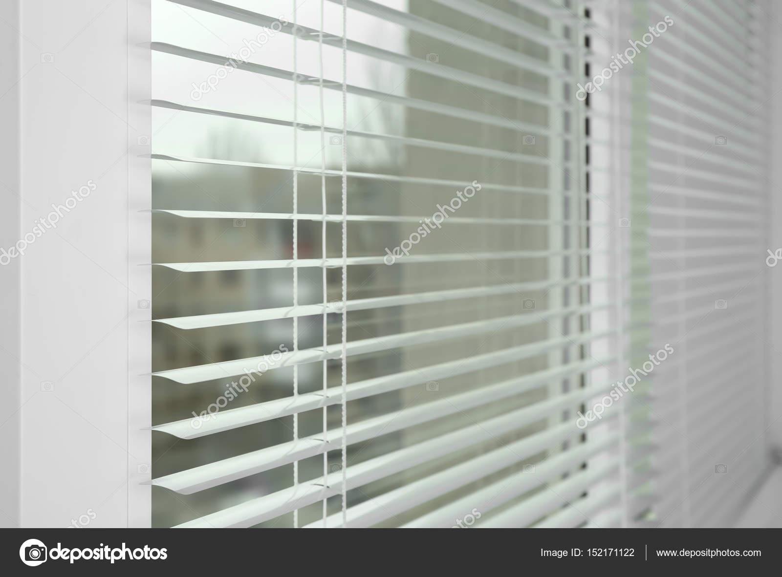 Window with white jalousie — Stock Photo © belchonock #152171122