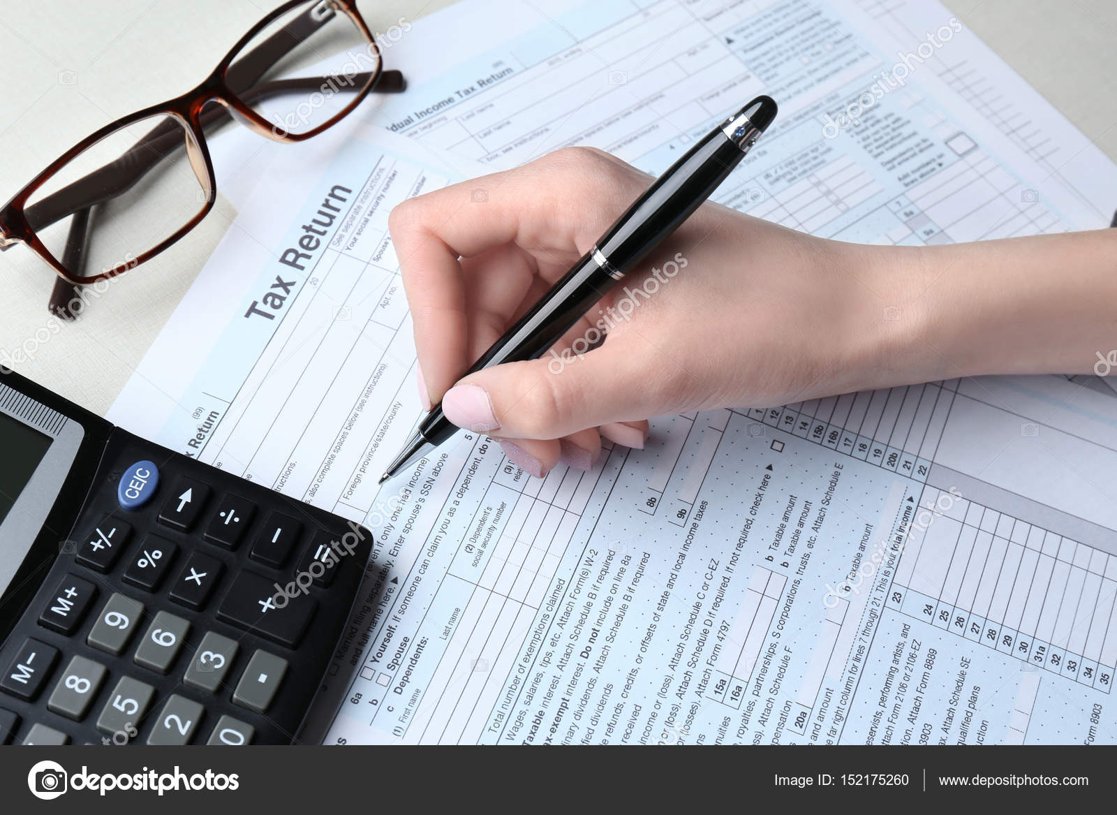woman filling in income tax form — stock photo © belchonock #152175260