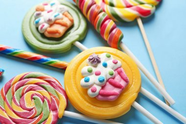 Composition with tasty lollipops