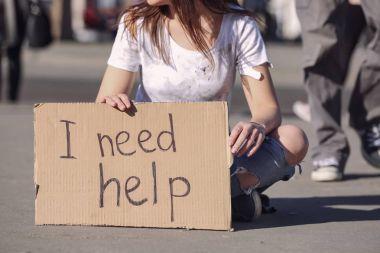 Poor woman begging for help