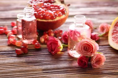 Perfume bottles, roses and pomegranate