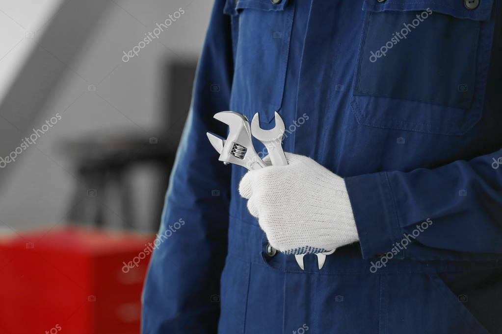 Auto mechanic with tools