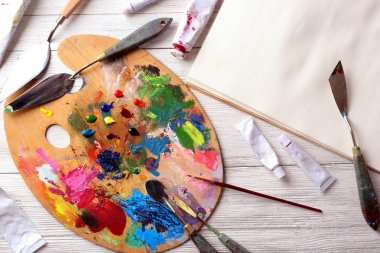 palette, oil paints and painting tools