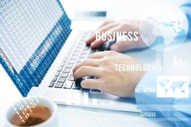 Man using laptop, closeup