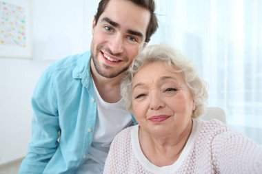 Young man with grandmother