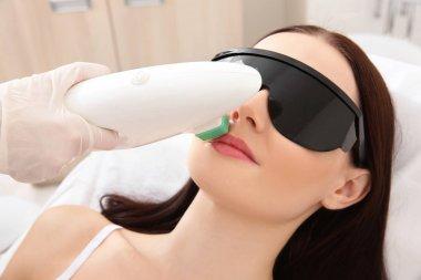 woman getting laser epilation