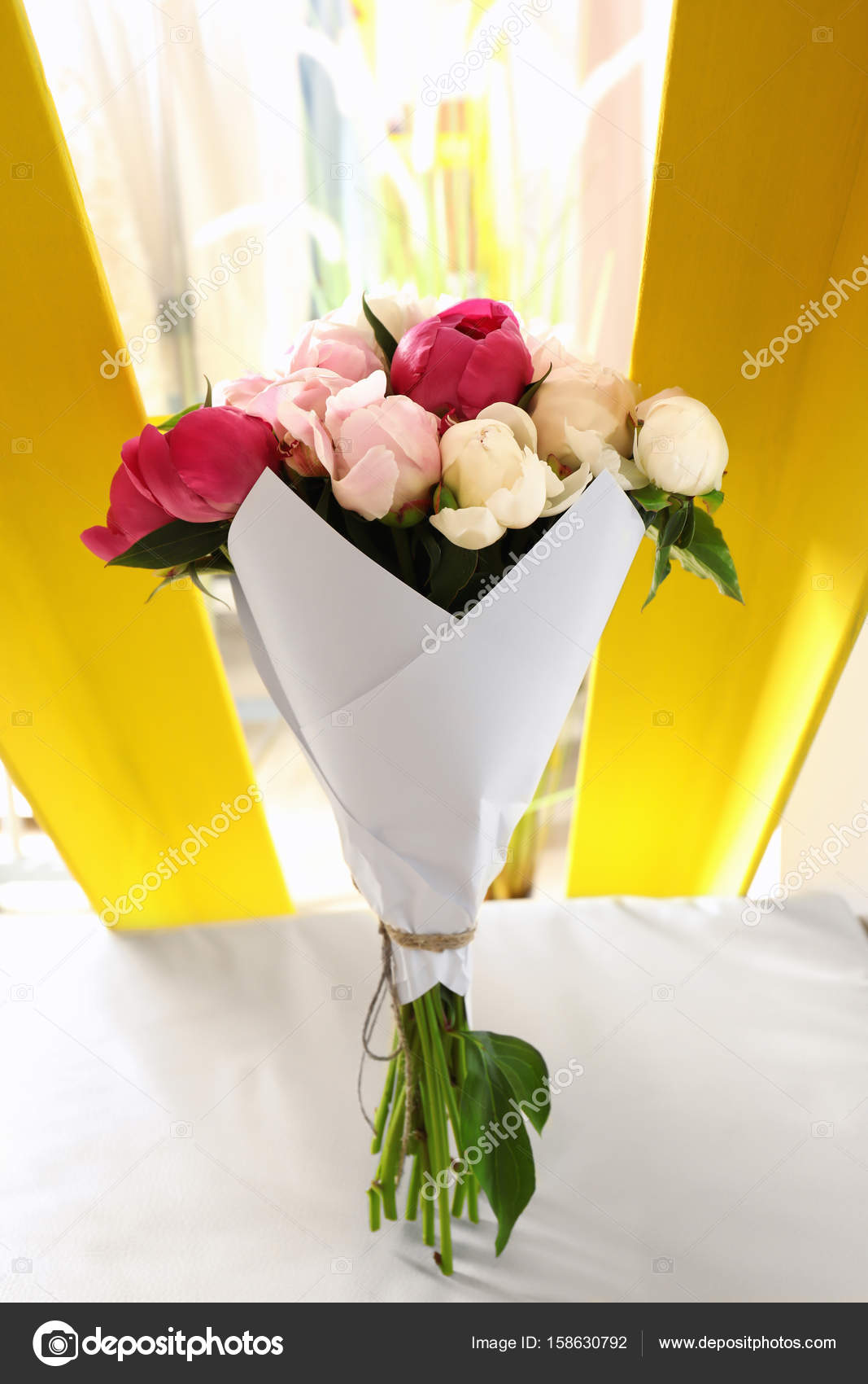 Bouquet Of Beautiful Colorful Peony Flowers On Leather Chair In Room