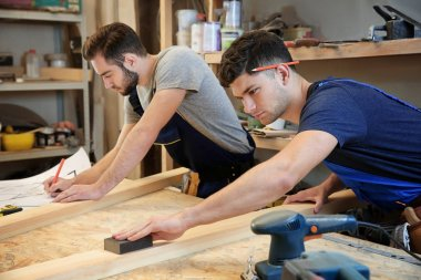 young carpenters working in shop
