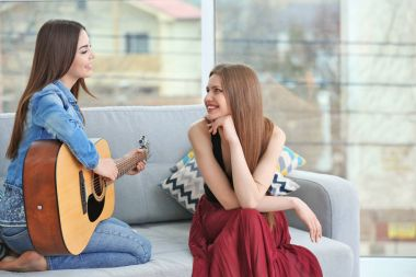 Lovely lesbian couple with guitar