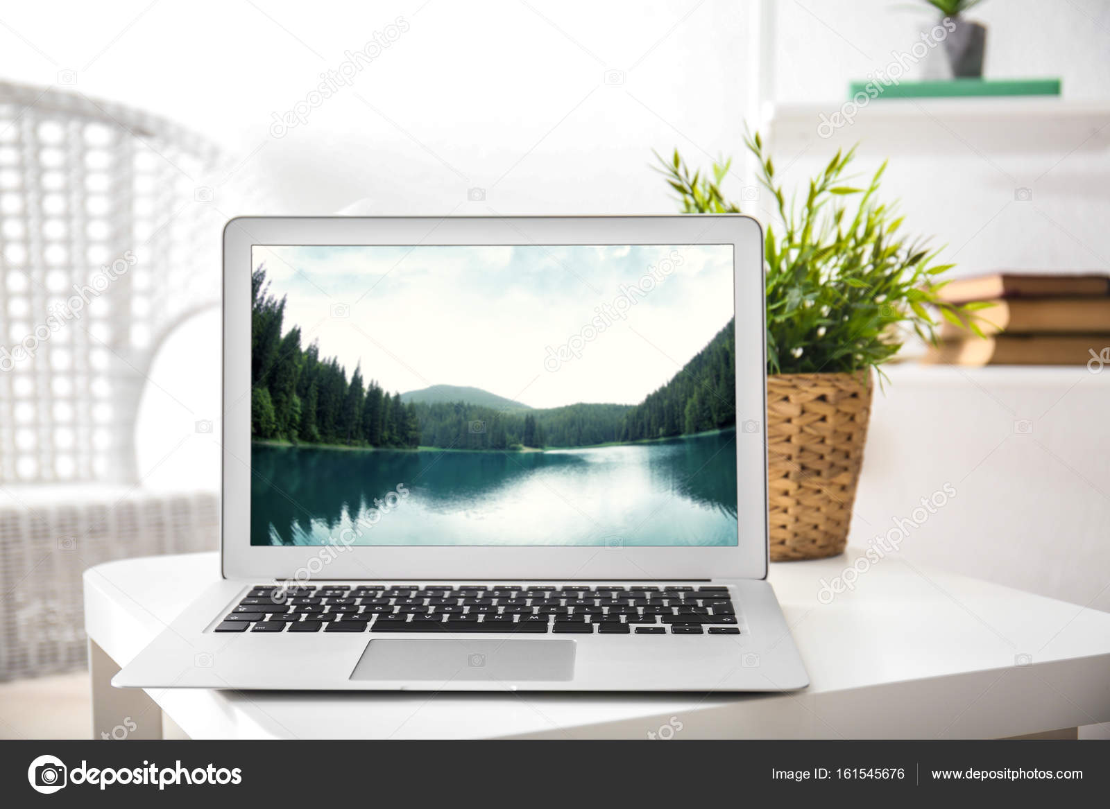 Workplace with laptop and wallpaper on screen — Stock Photo