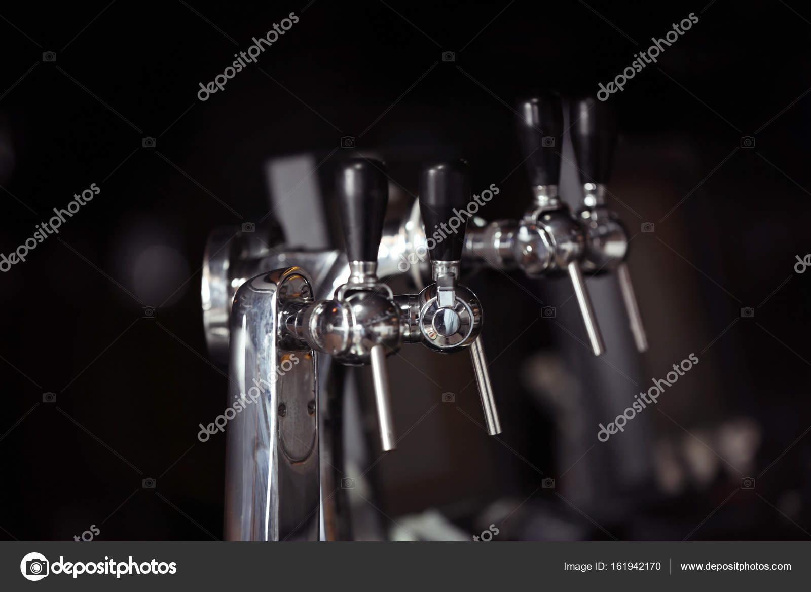 Beer taps on bar counter — Stock Photo © belchonock #161942170