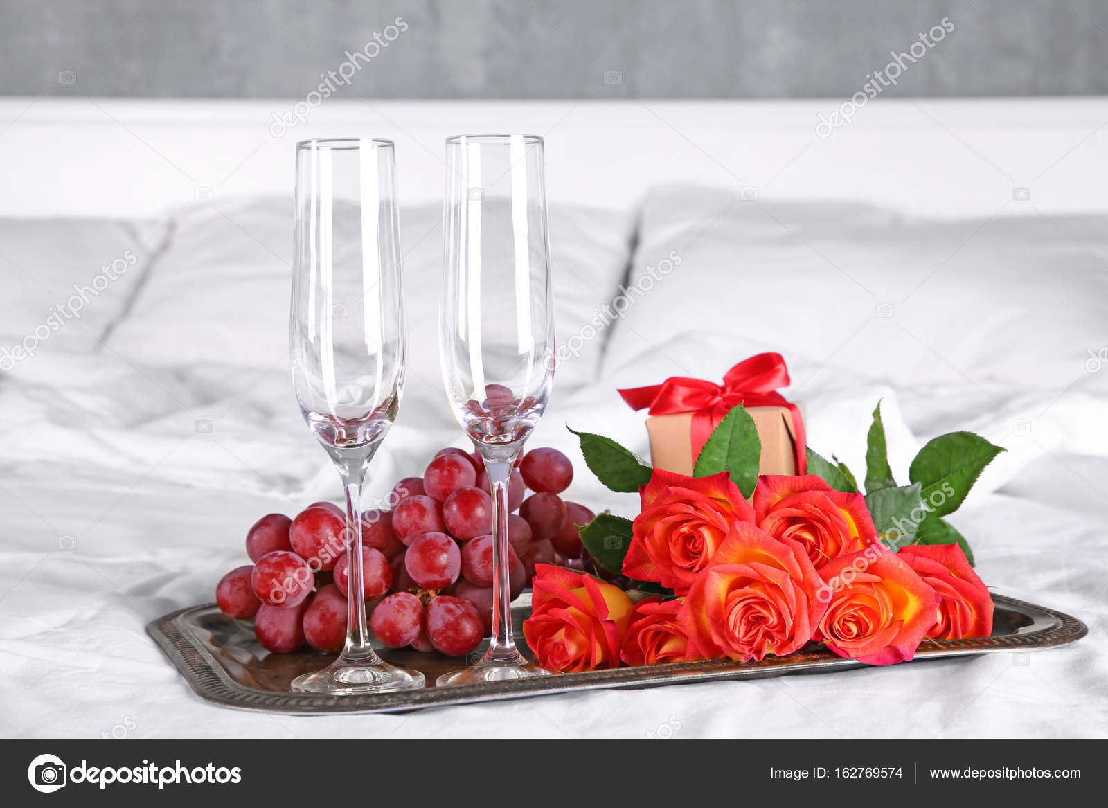 Tray With Empty Champagne Glasses Grape And Roses For Romantic Dinner On Bed Honeymoon Concept Stock Photo Image By Belchonock 162769574