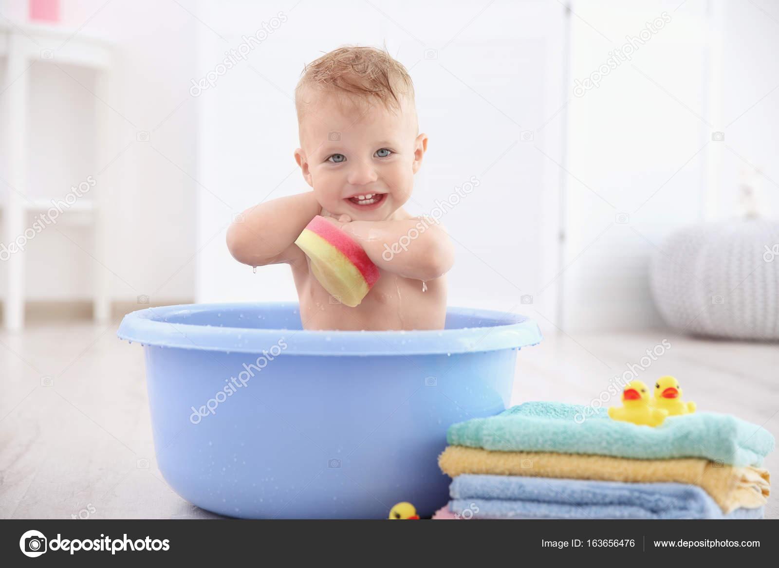 Little baby boy washing in bath basin at home — Stock Photo ...