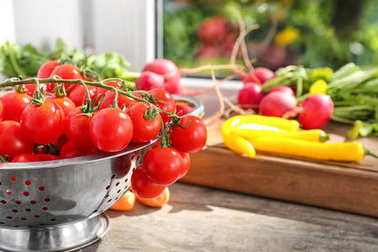 Colander with fresh cherry tomatoes
