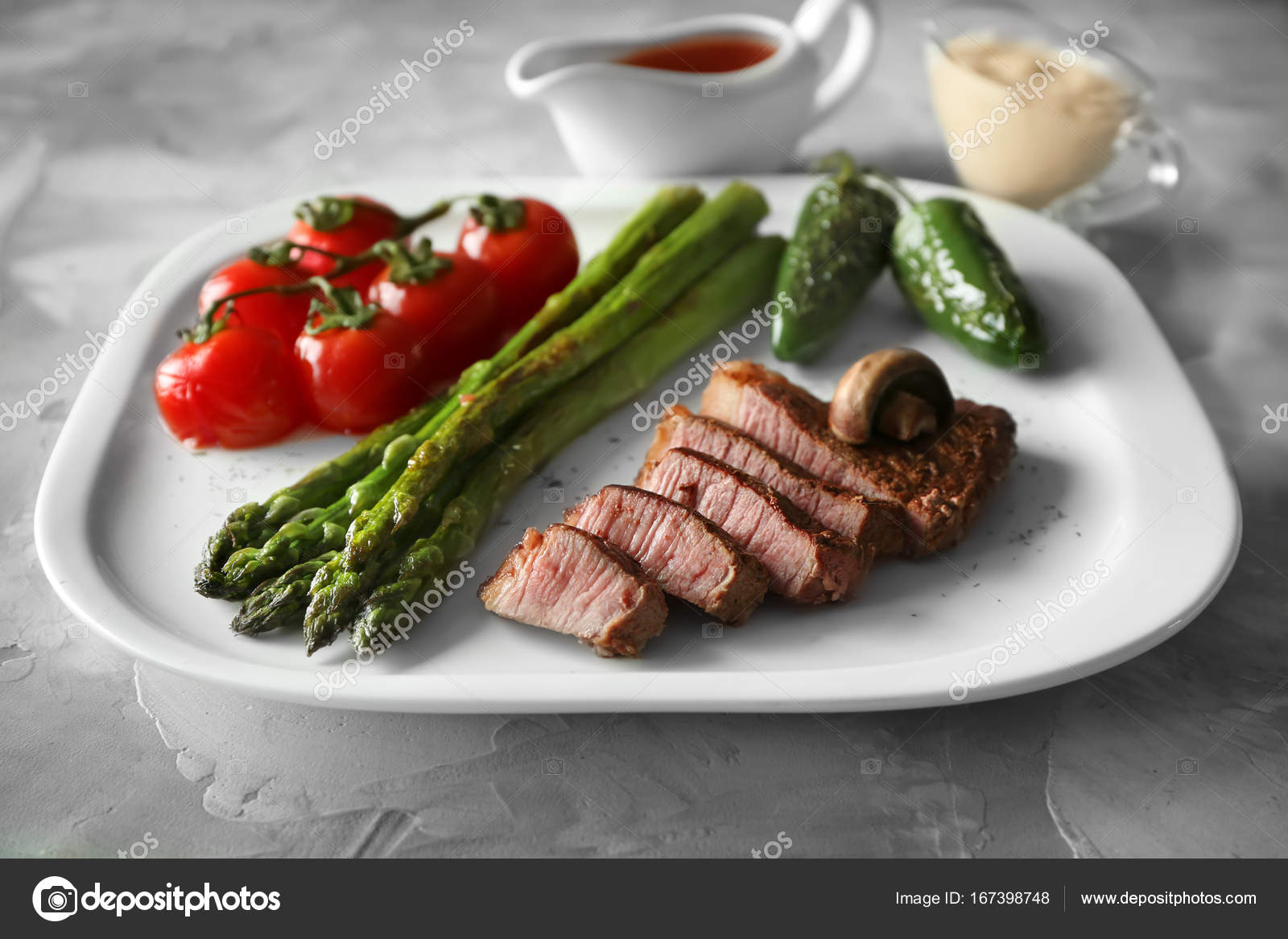 Sliced Steak On White Plate Stock Photo C Belchonock 167398748