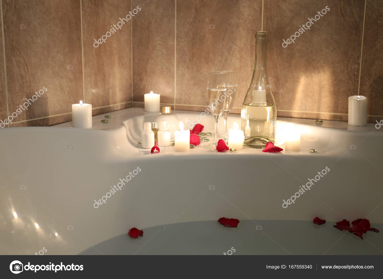 bathtub filled with water and rose petals — Stock Photo © belchonock ...