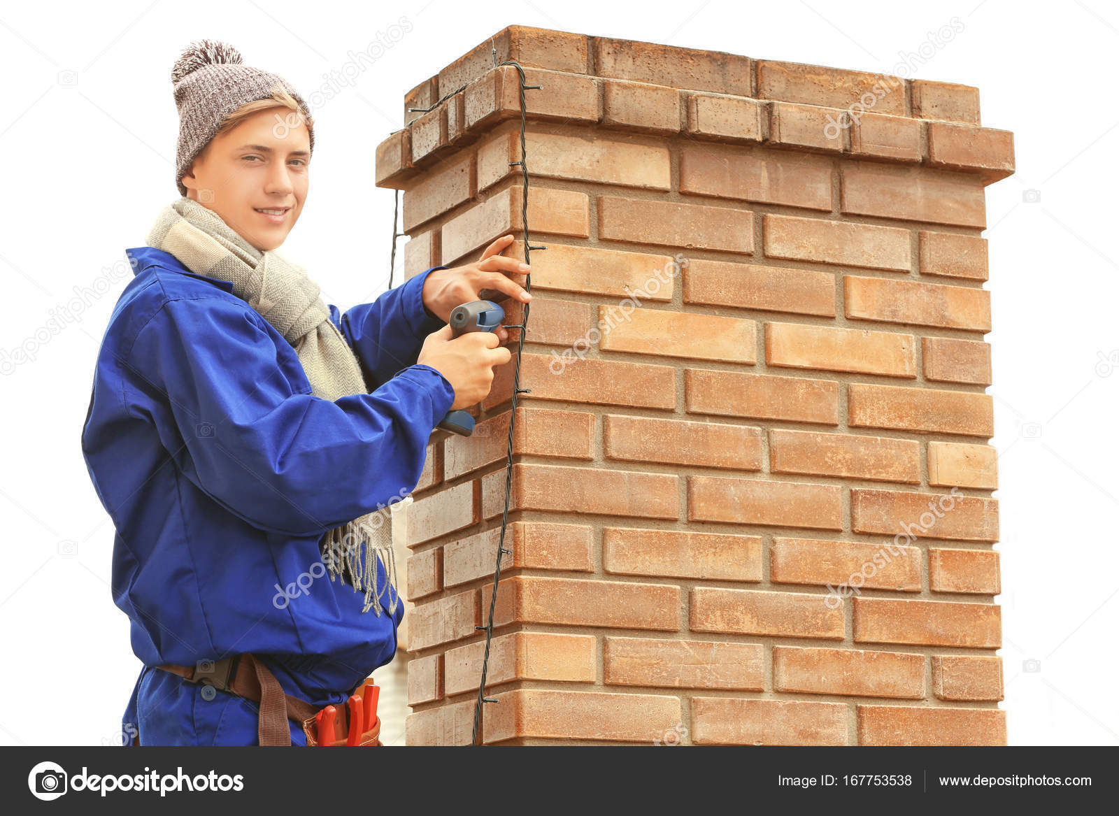What Can I Use To Attach Christmas Lights To Brick young man hanging christmas lights on chimney of house