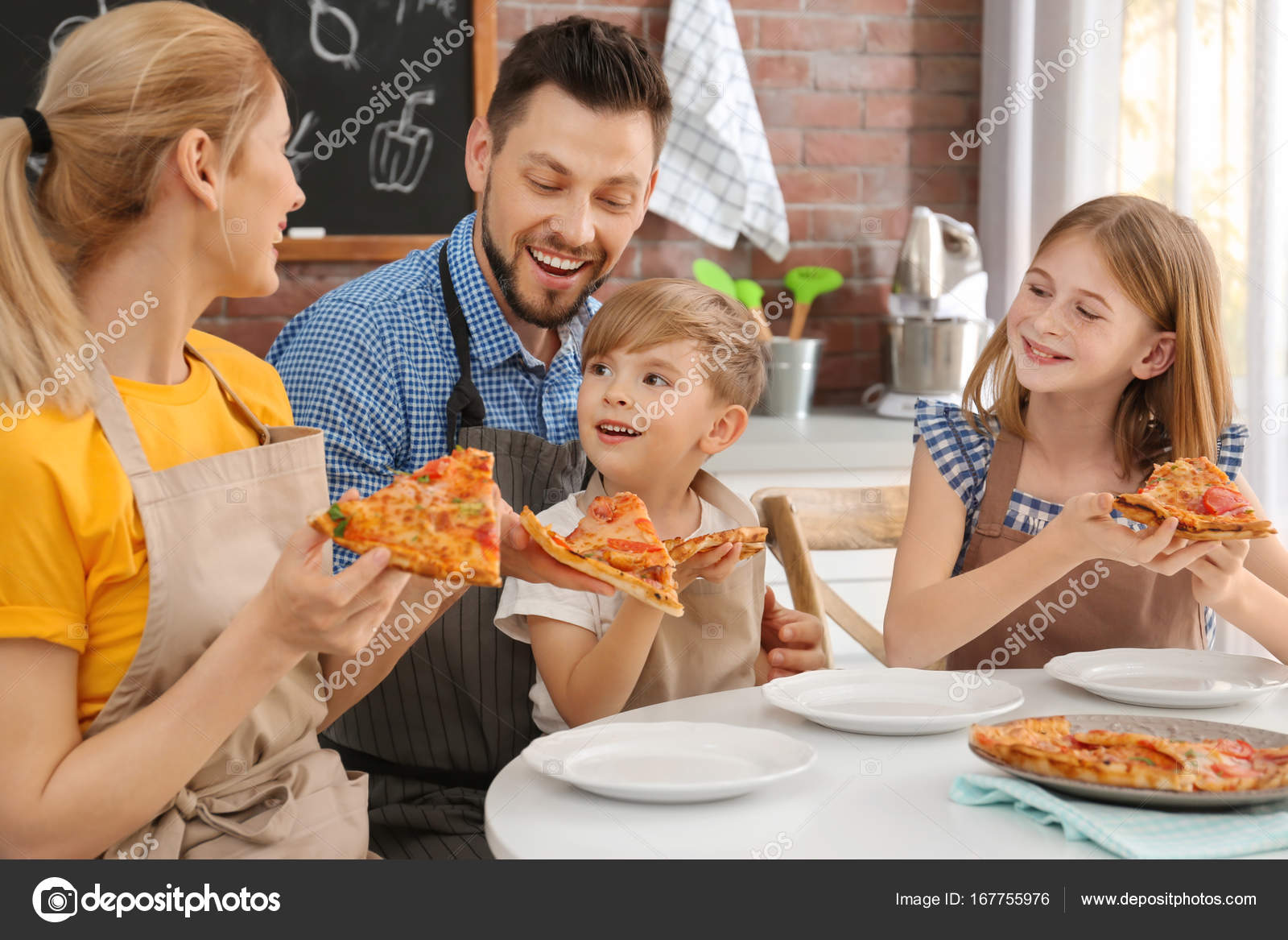 Family eating yummy pizza together in kitchen. Cooking ...
