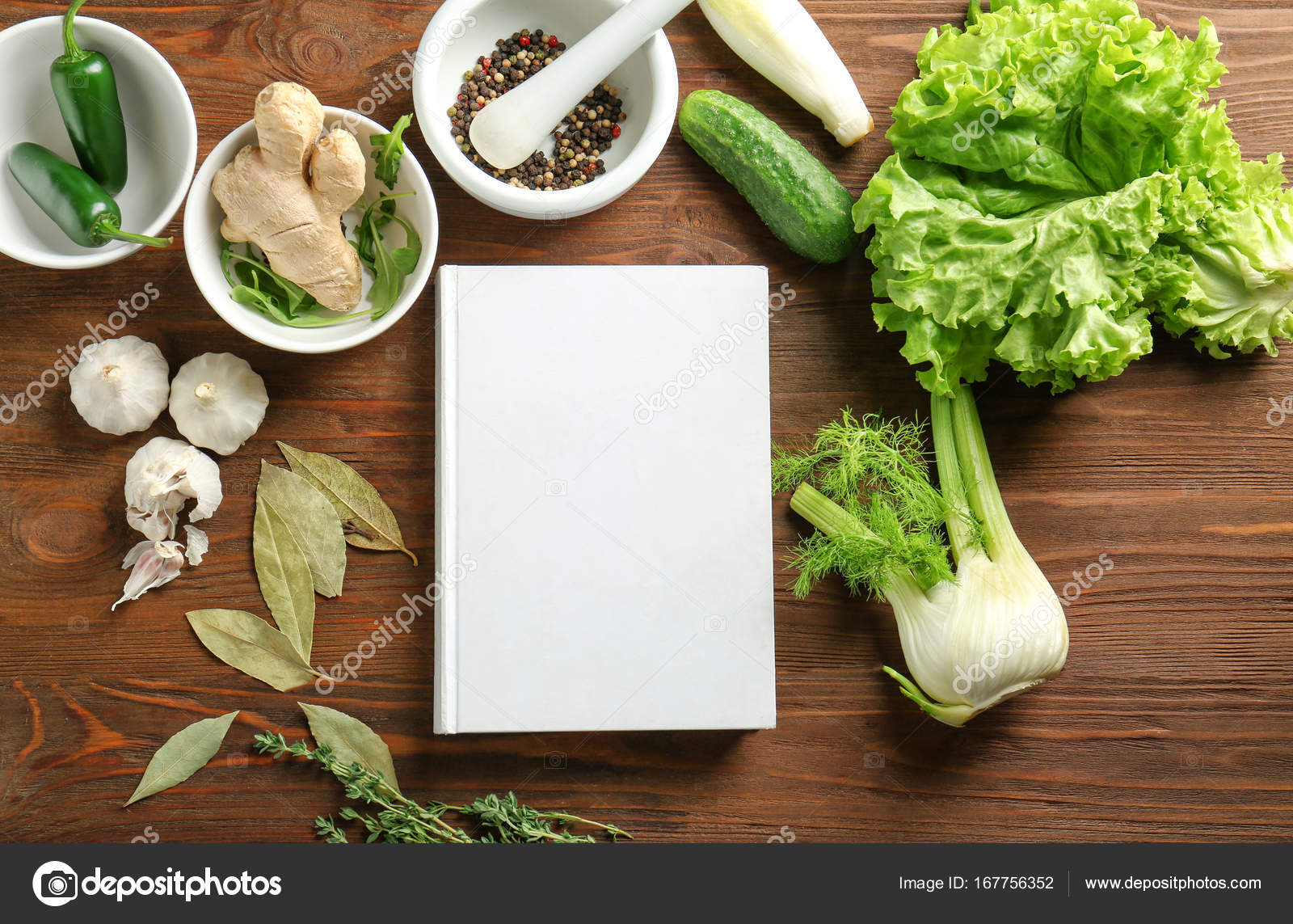 Notebook and vegetables on kitchen table. Cooking classes concept ...