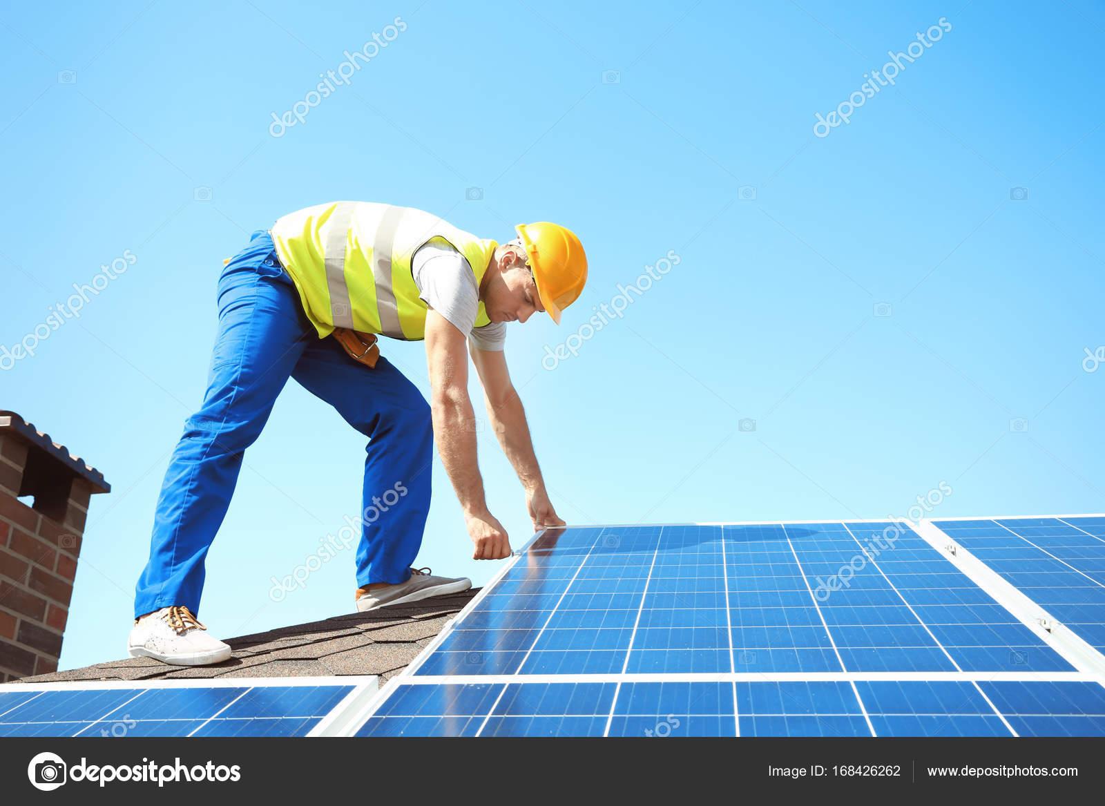 Worker installing solar panels outdoors — Stock Photo © belchonock ...