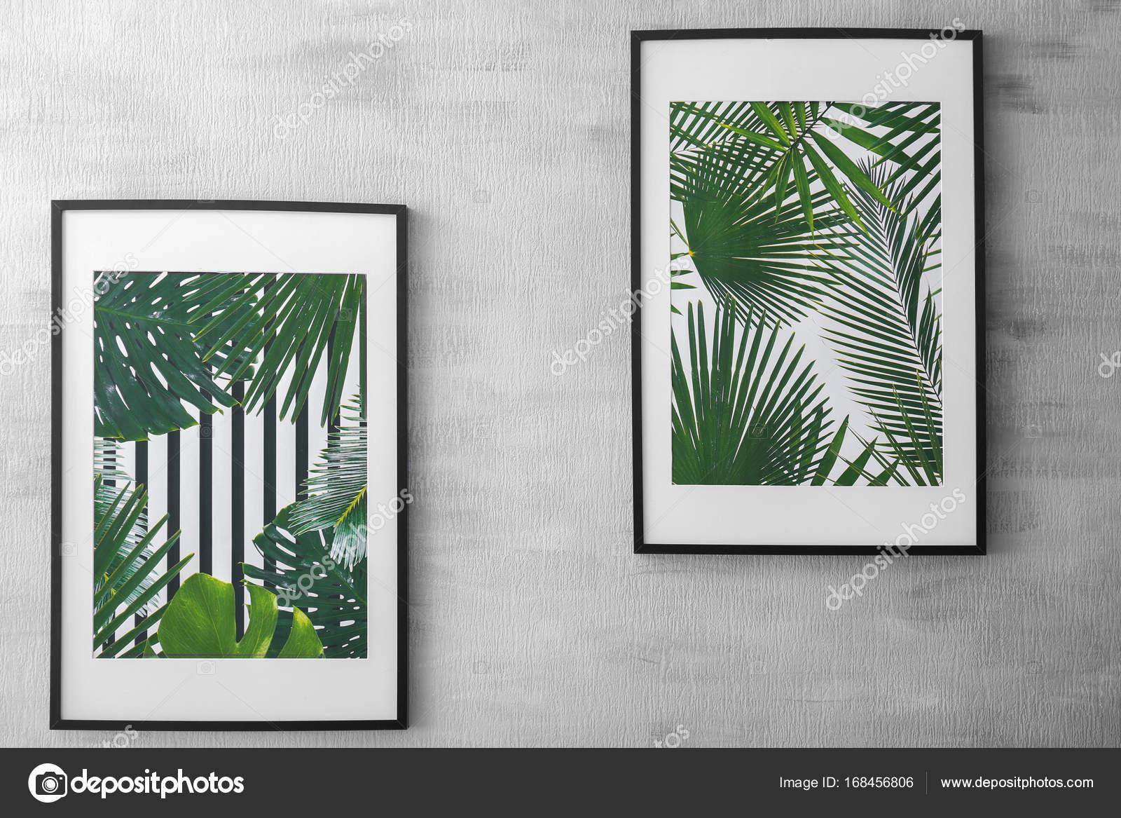 Enmarcado de cuadros de hojas tropicales sobre fondo gris — Foto de ...