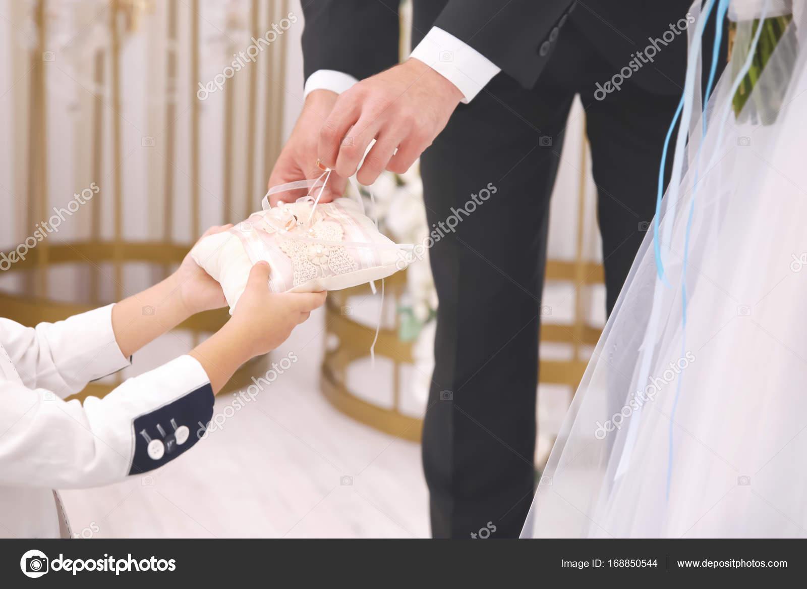 Little Boy Handing Wedding Rings To Couple Indoors Stock Photo: Wedding Band Little Boy At Reisefeber.org