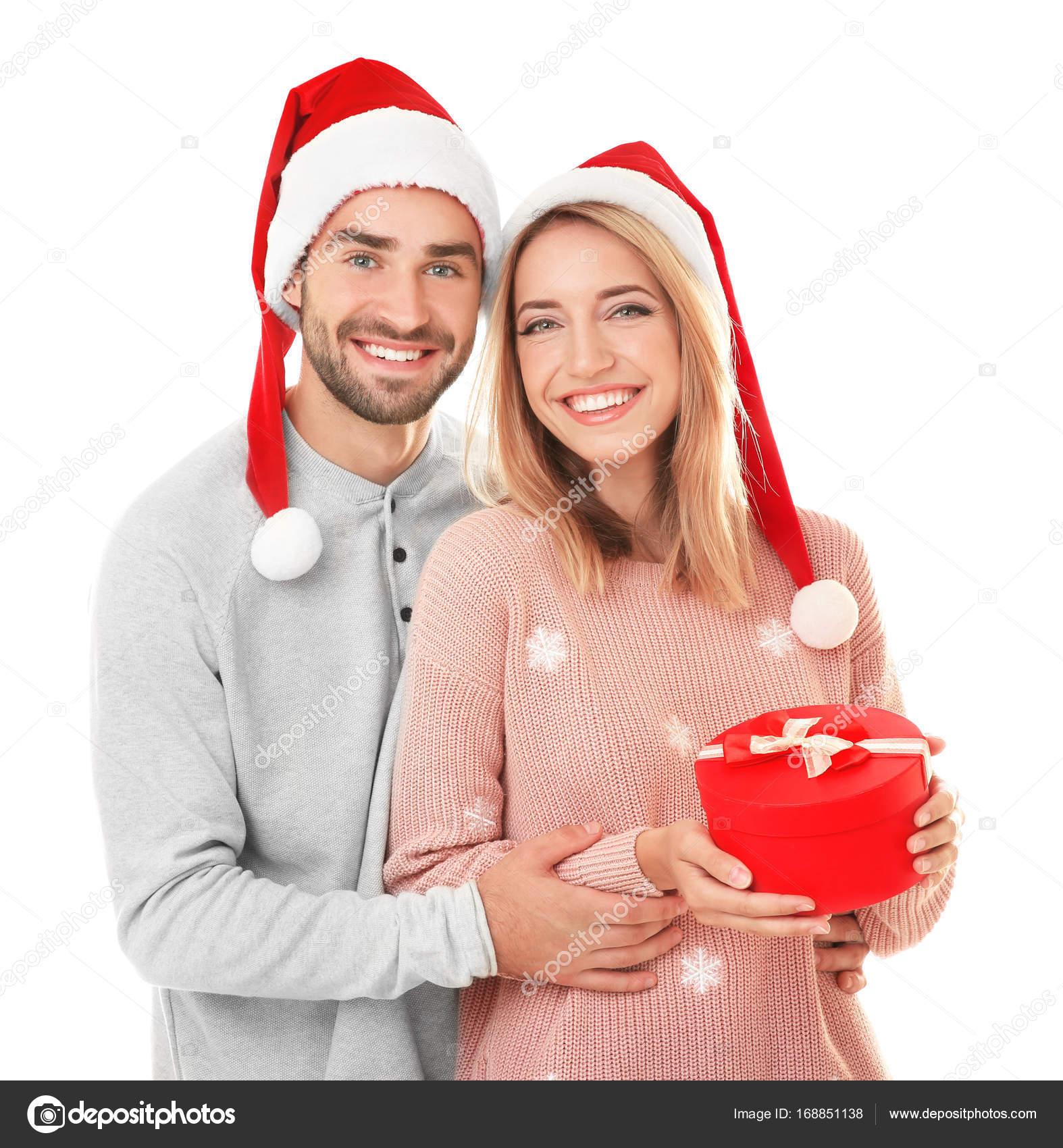jeune couple avec le cadeau de no l photographie belchonock 168851138. Black Bedroom Furniture Sets. Home Design Ideas