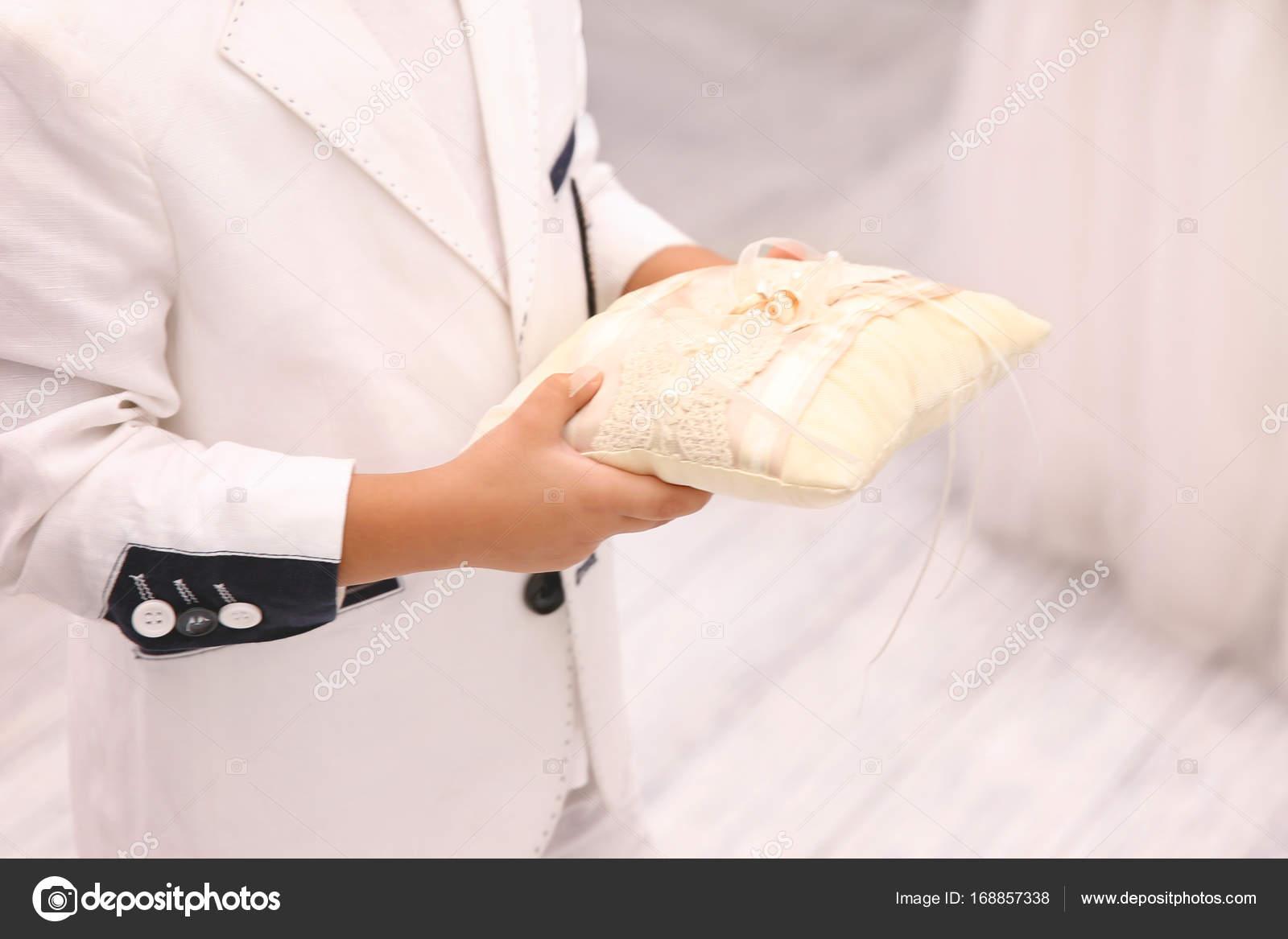 Little Boy Holding Wedding Rings On Pillow Indoors Stock Photo: Wedding Band Little Boy At Reisefeber.org