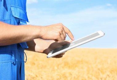 Male farmer holding tablet