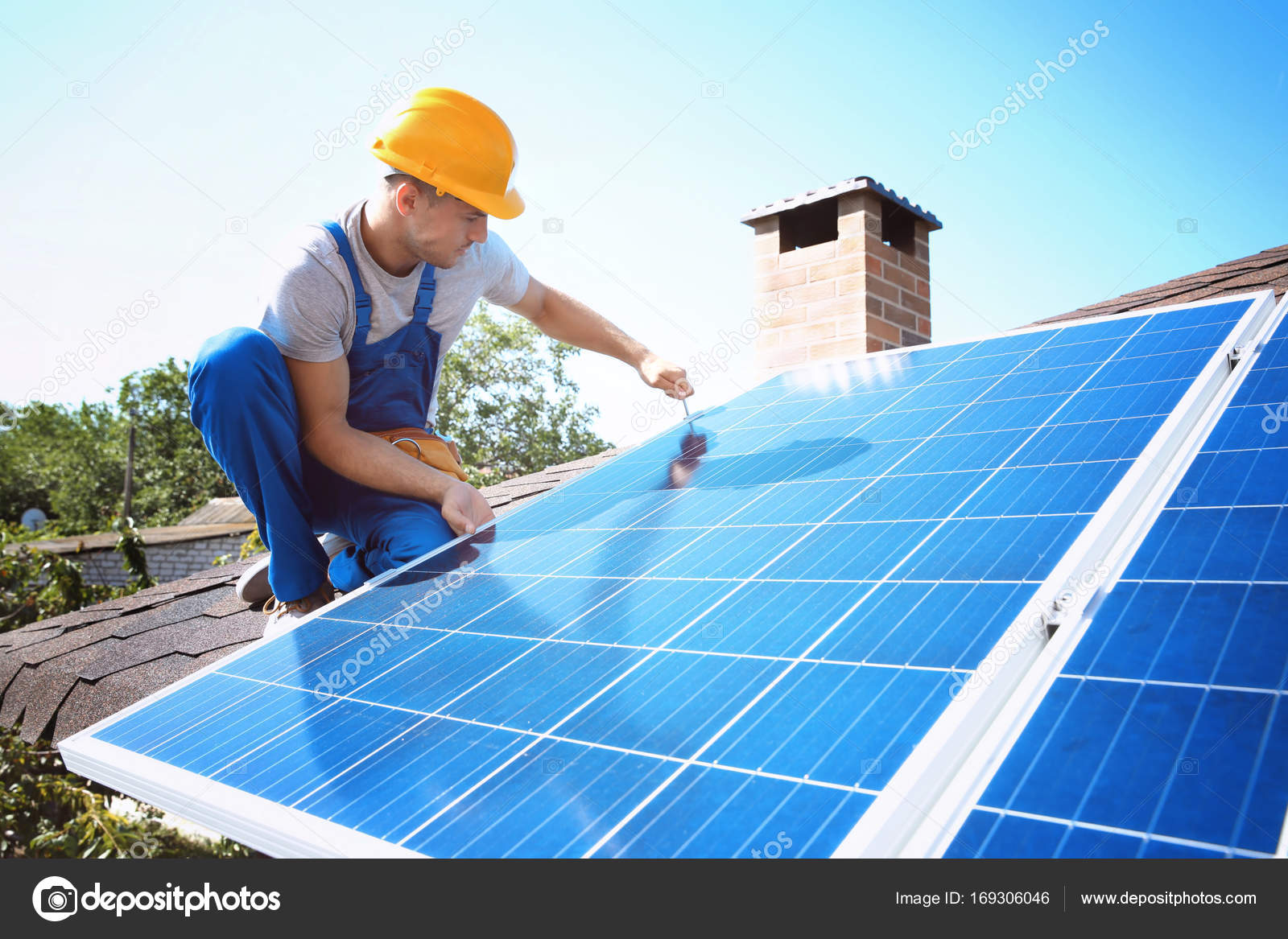 Worker installing solar panels — Stock Photo © belchonock #169306046