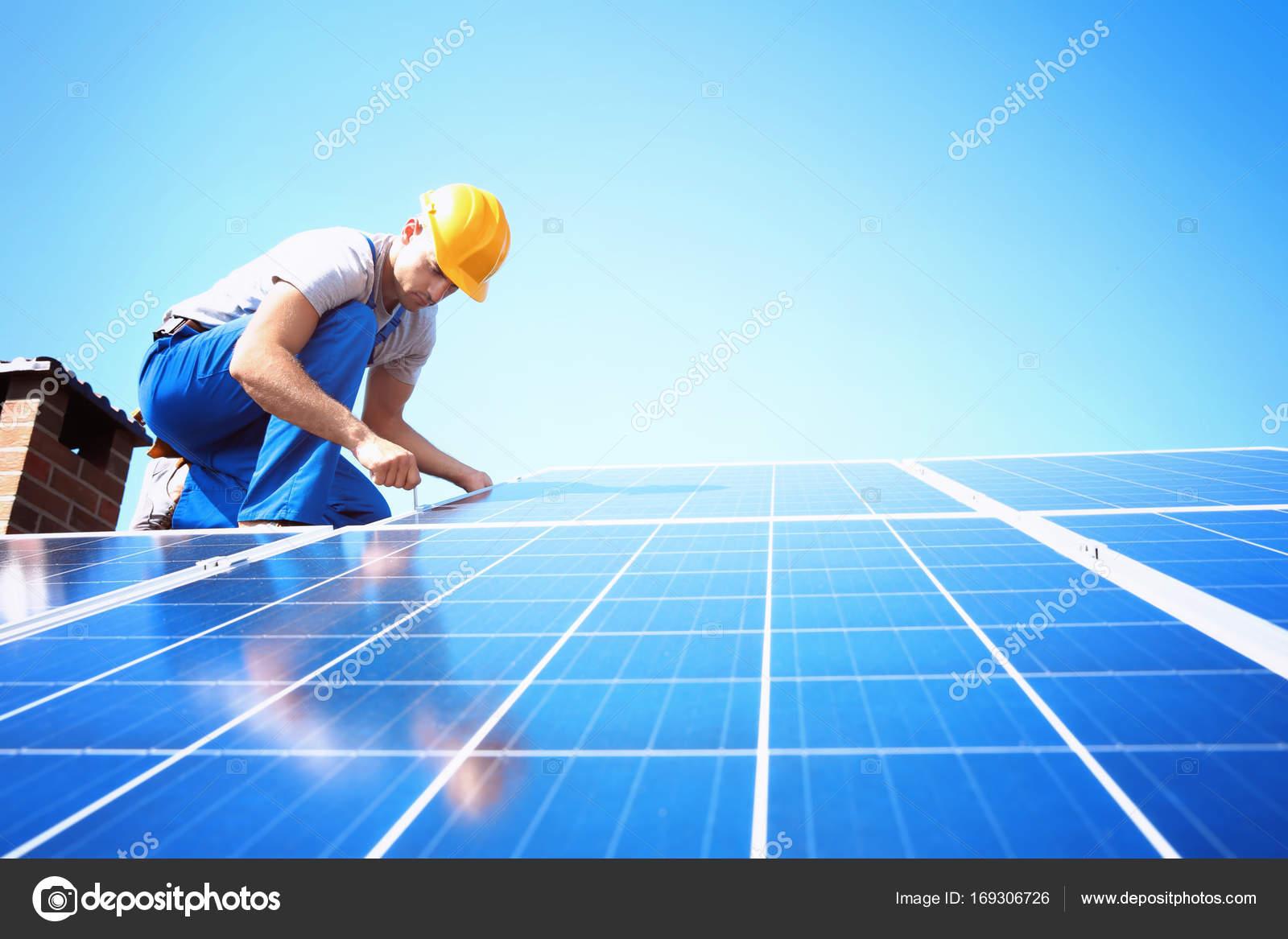 Worker installing solar panels — Stock Photo © belchonock #169306726