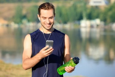 Sporty young man listening to music