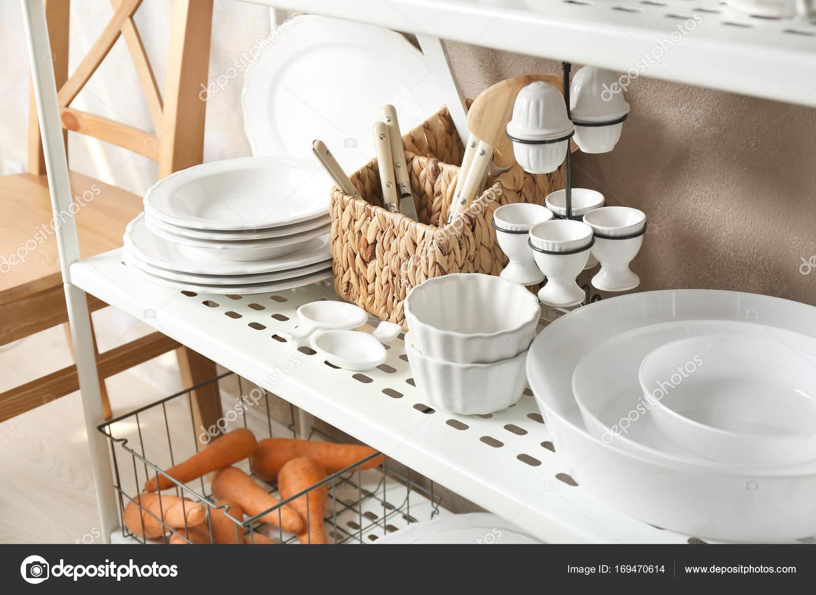 White kitchenware on storage stand indoors — Stock Photo ...