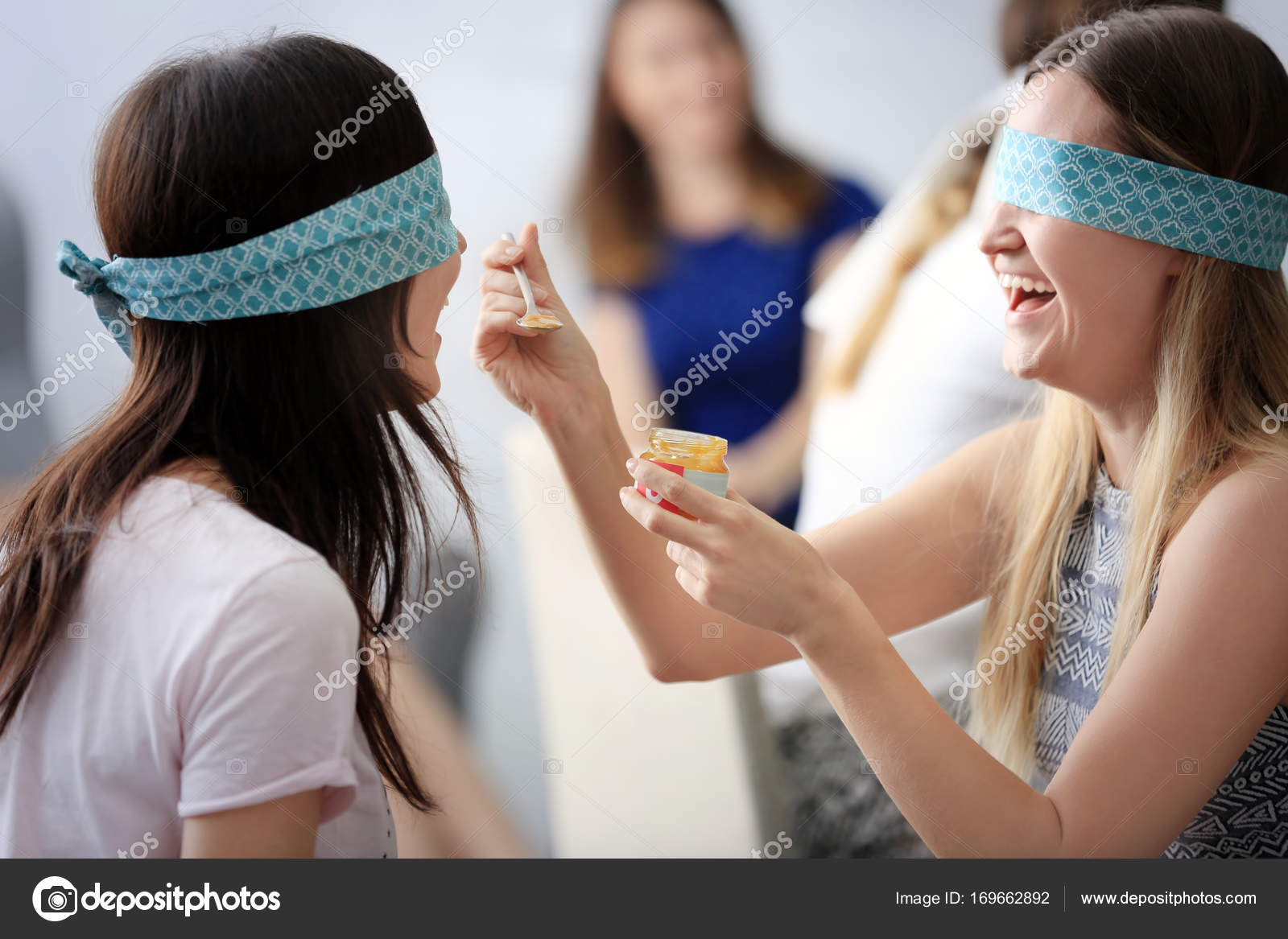 Women Taking Part In Game At Baby Shower Party Stock Photo