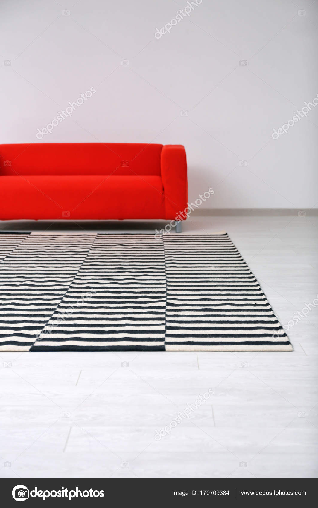 Black and white striped carpet on floor