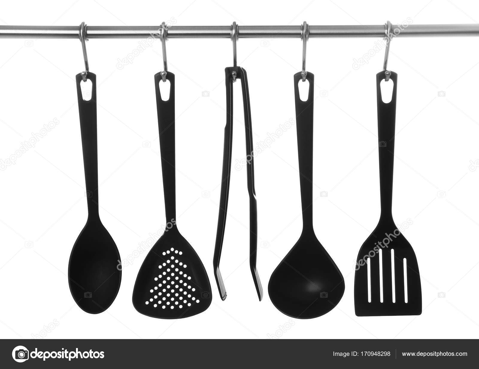 Set Of Cooking Utensils Hanging On Rack U2014 Stock Photo