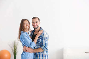 Young happy couple at new home