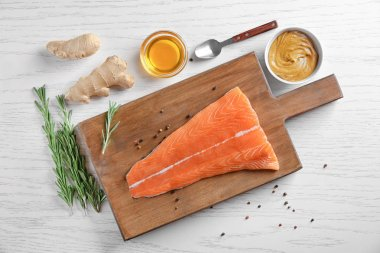Fresh salmon fillet and ingredients for marinade