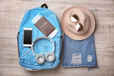 Composition with passport and baggage