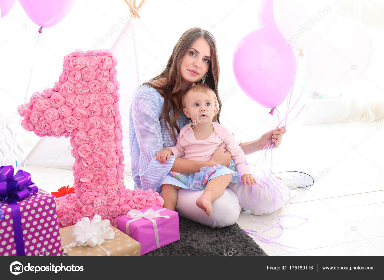 Young Mother And Cute Baby With Birthday Presents At Home Stock Photo